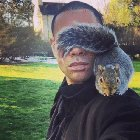 cQWSrO 5bdu9ySwqMIHry4XpQeDS5aBXiPhFr9GNRh4 Handsome man with a shoulder squirrel
